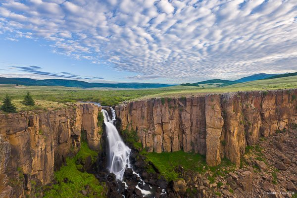 The morning clouds start to break over North Clear Creek Falls outside of Lake City, Colorado.