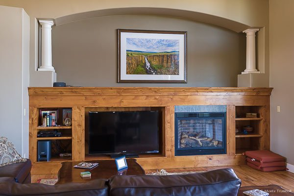 30x45 framed fine art print hanging above fireplace in Colorado home.